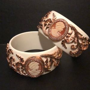Pair of cameo bangle bracelets with floral detail